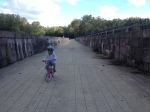 Kate riding across the Monocacy Aqueduct